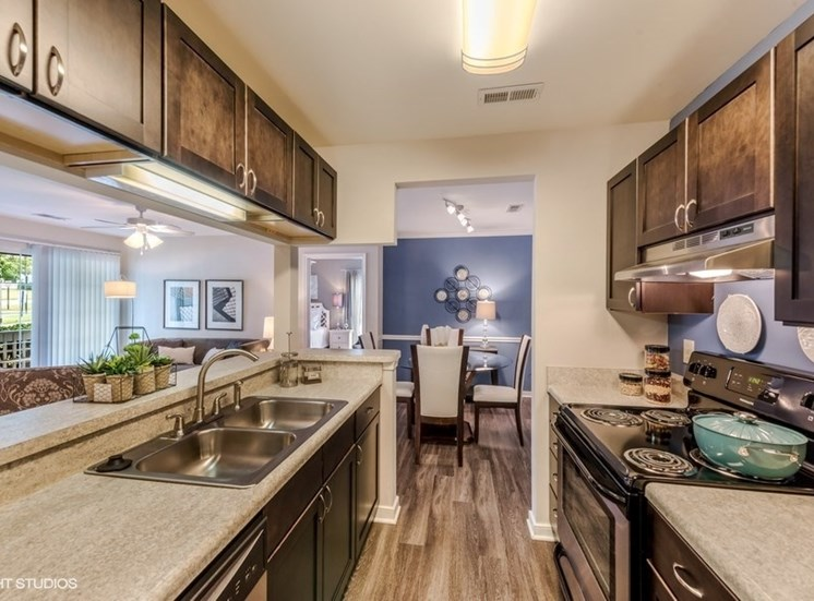 Fitted Kitchen With Island Dining at Brittany Commons Apartments, Spotsylvania, 22553